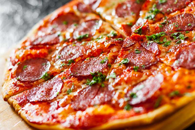 sliced Pepperoni Pizza with Mozzarella cheese, salami, Tomatoes,